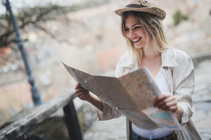 Happy female tourist sightseeing and exploring