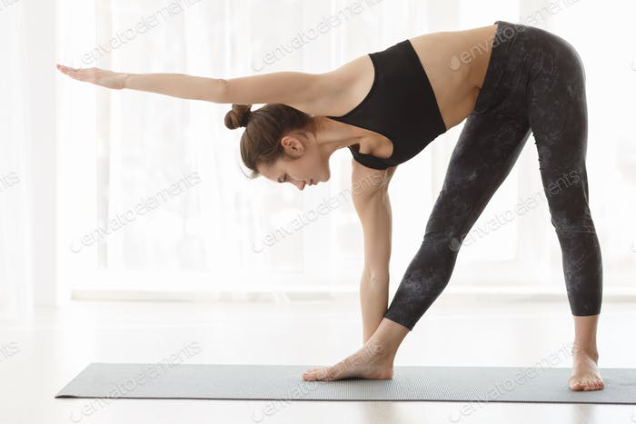 Find your harmony. Fit girl making yoga poses at studio