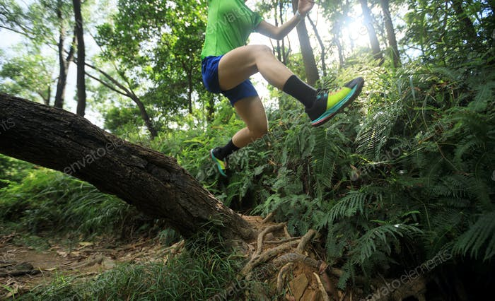 Ultra marathon runner running in tropical rainforest