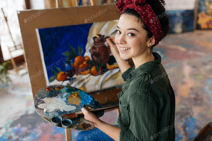 Young beautiful smiling woman with dark curly hair sitting on ch