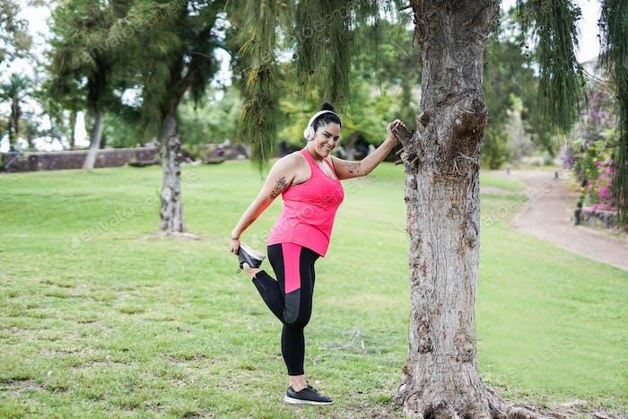 Active curvy woman doing sport outdoor