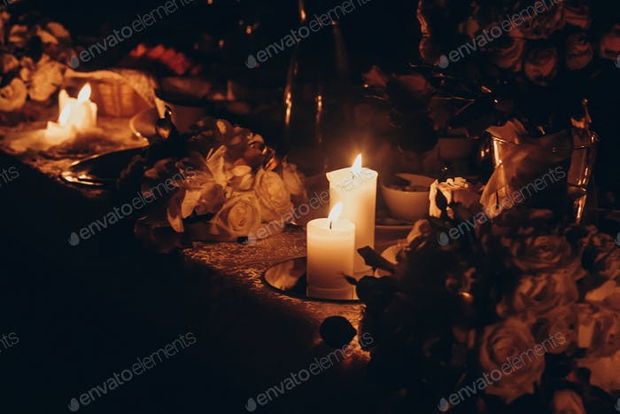 candle light and decor. candles burning on golden candlestick
