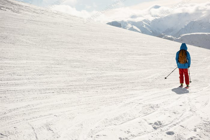 Skier skiing on snow covered mountains
