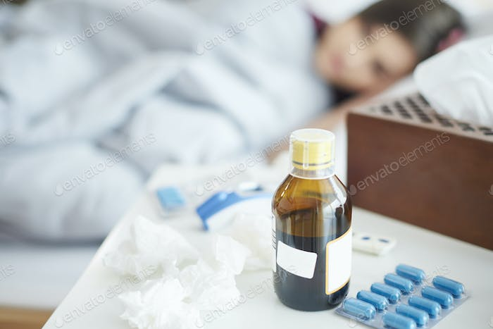 Close up of pills and syrup