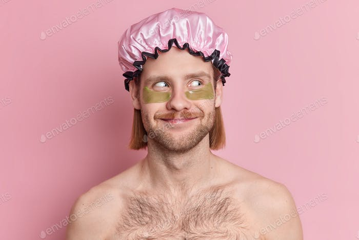 Skin care concept. Satisfied European man has mustache and bristle looks away stands topless indoor