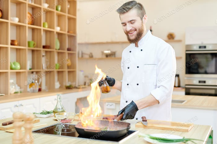 Cheerful Chef Cooking Flambe