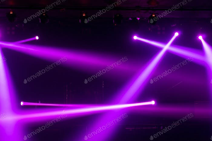 Abstract blurred photo of spotlight on the stage in conference hall or nightclub,