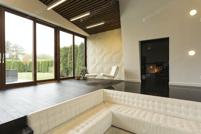 Futuristic living room with fireplace