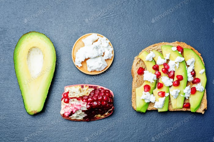 Sandwich with avocado, feta and pomegranate