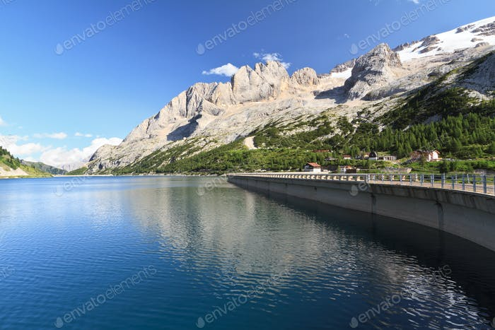 Fedaia lake and Marmolada glacier
