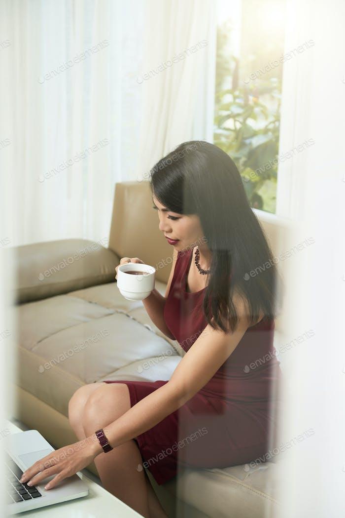 Female entrepreneur checking e-mails