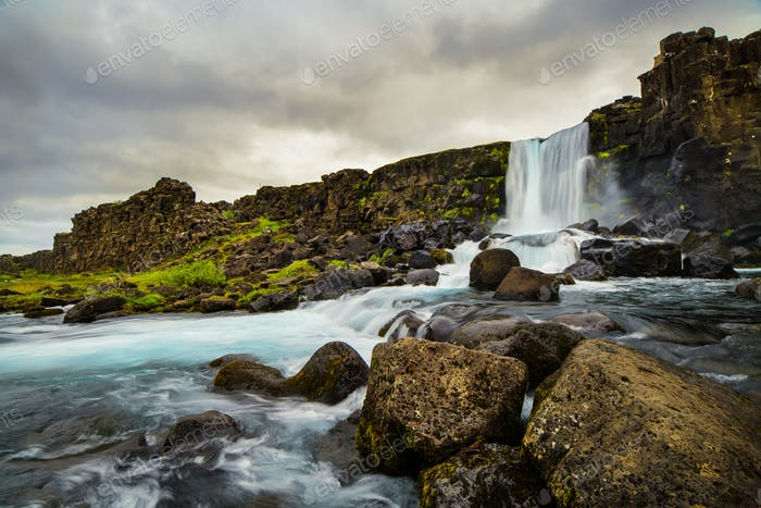 A waterfall in a beautiful Iceland landscape.