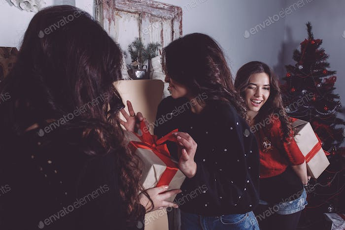 Beautiful girl exchange gifts for the new year. Decorative vinta