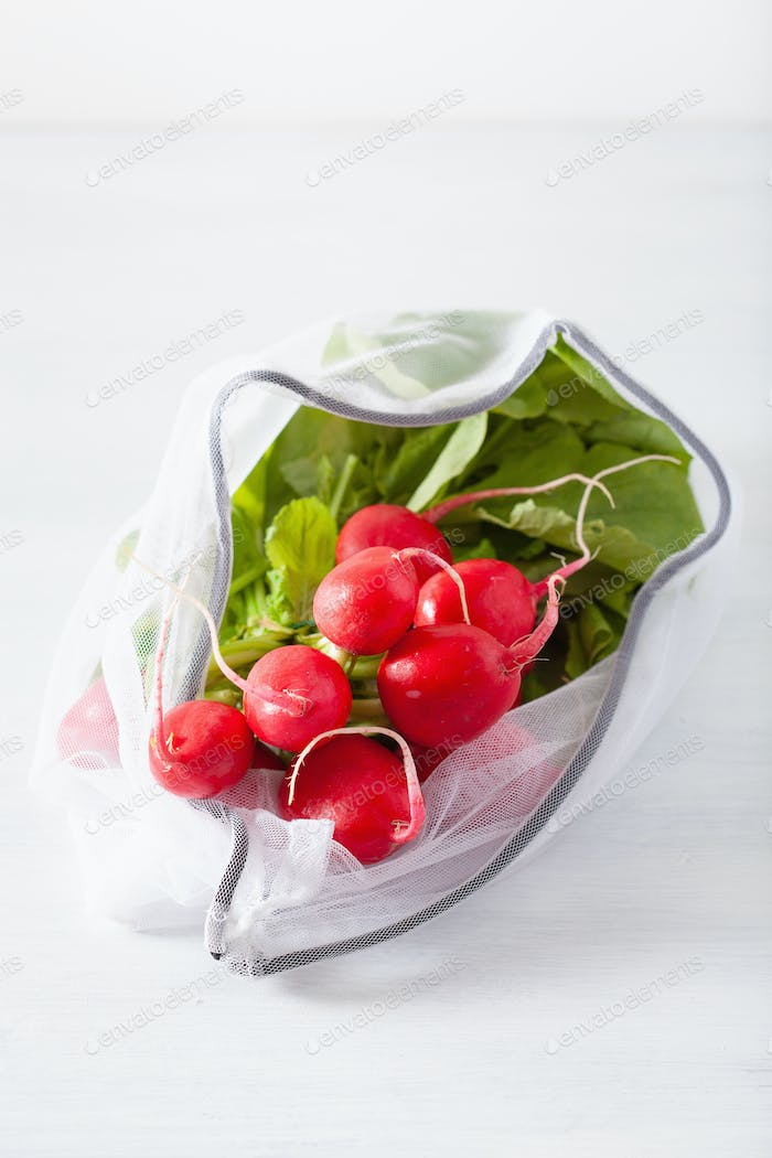 radish vegetable in reusable mesh nylon bag, plastic free zero waste concept