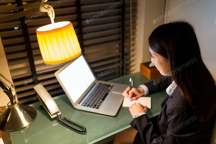 Business woman working on notebook computer