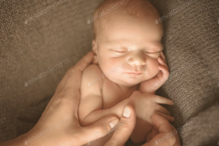 Woman hands care of newborn baby. Mom and her child. Maternity, family, care and birth concept. Copy