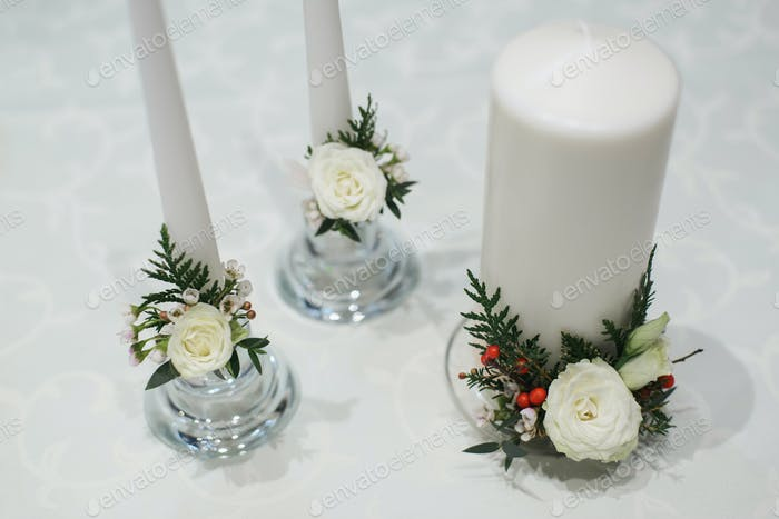 white thick and thin candles for wedding decoration
