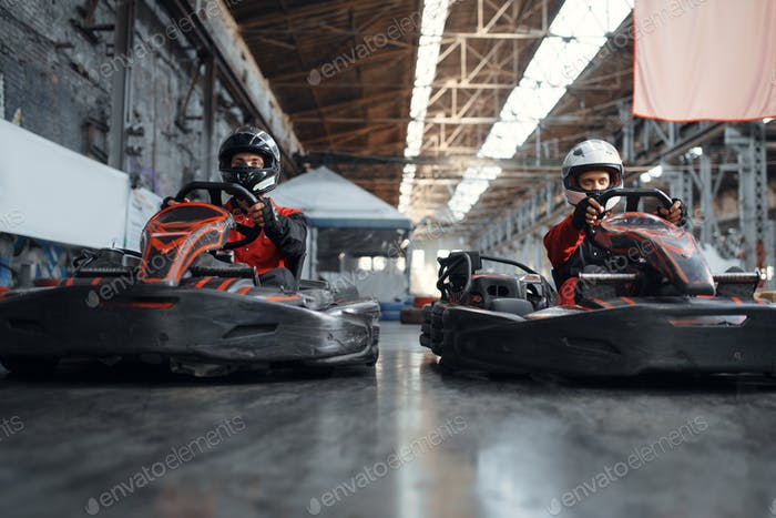Two kart racers fight for victory, side view