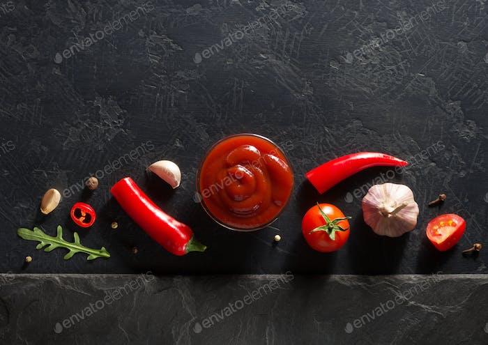 tomato sauce on black background