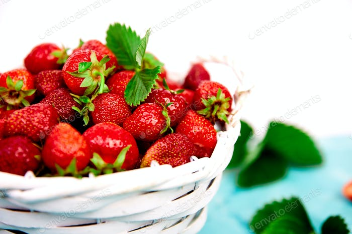 Strawberries in white basket. Fresh strawberries.