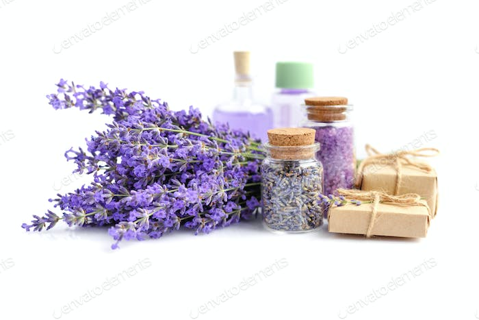 Spa products and lavender flowers on a white background