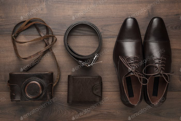 Brown Shoes, Purse, Belt, And Film Camera