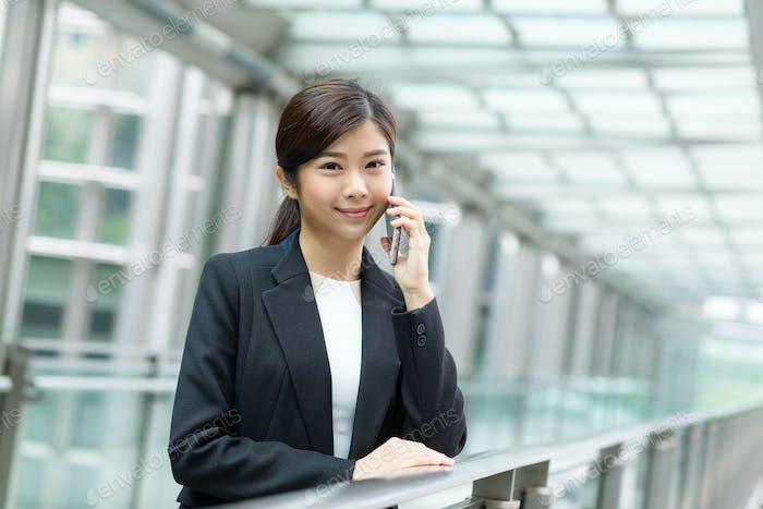 Businesswoman calling on cellphone