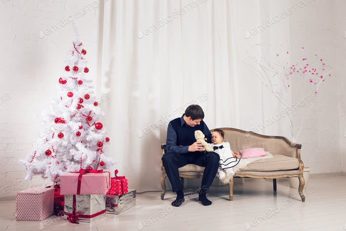 happy family father and child baby daughter with Christmas tree
