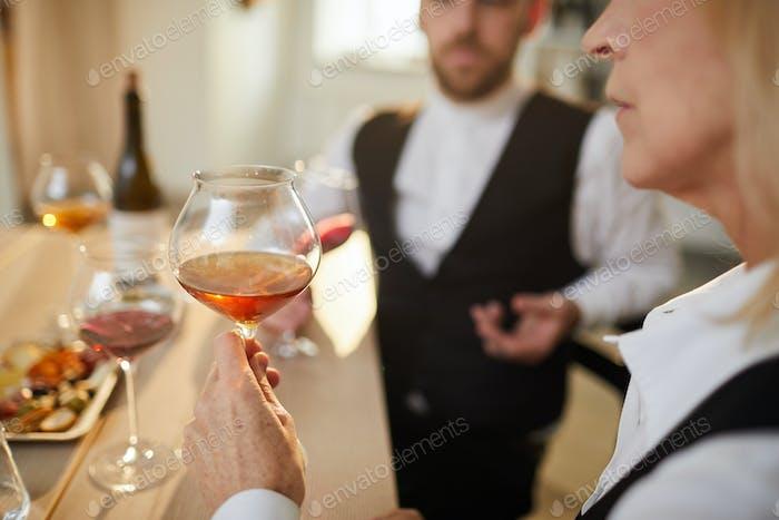 Sommelier Examining Wine Closeup