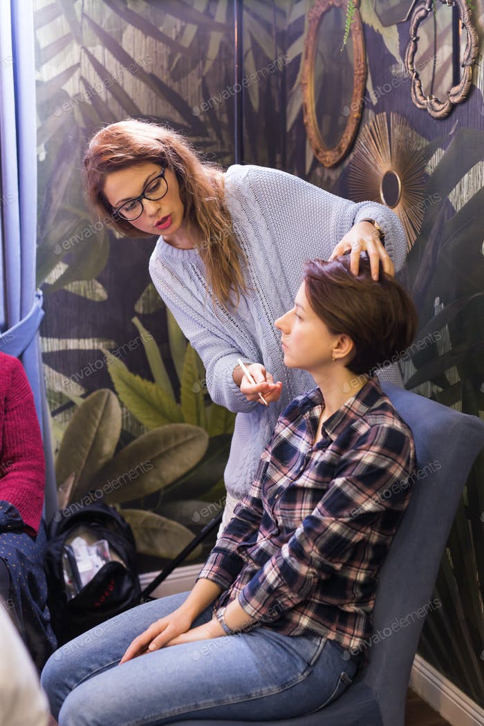 Make-up artist conducts a master class to improve the skills of a beginner make-up artist