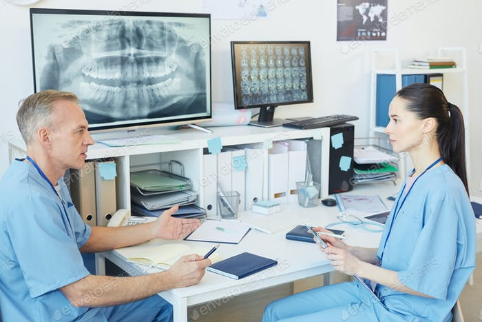Dentists Discussing Case in Clinic