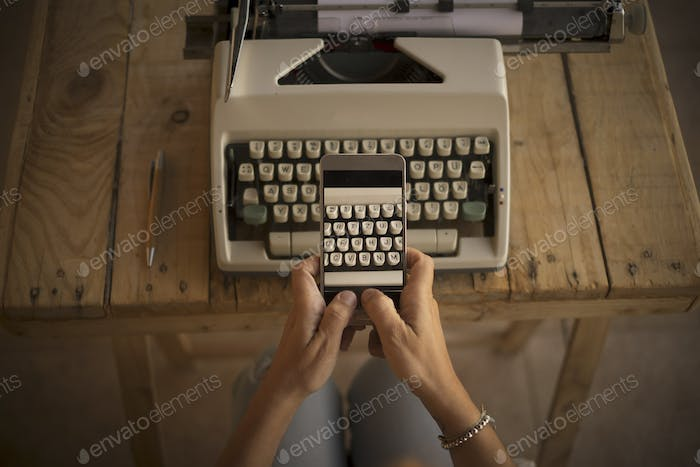 Concept of write and work  with old and modern new technlology - typwriter and modern cellular