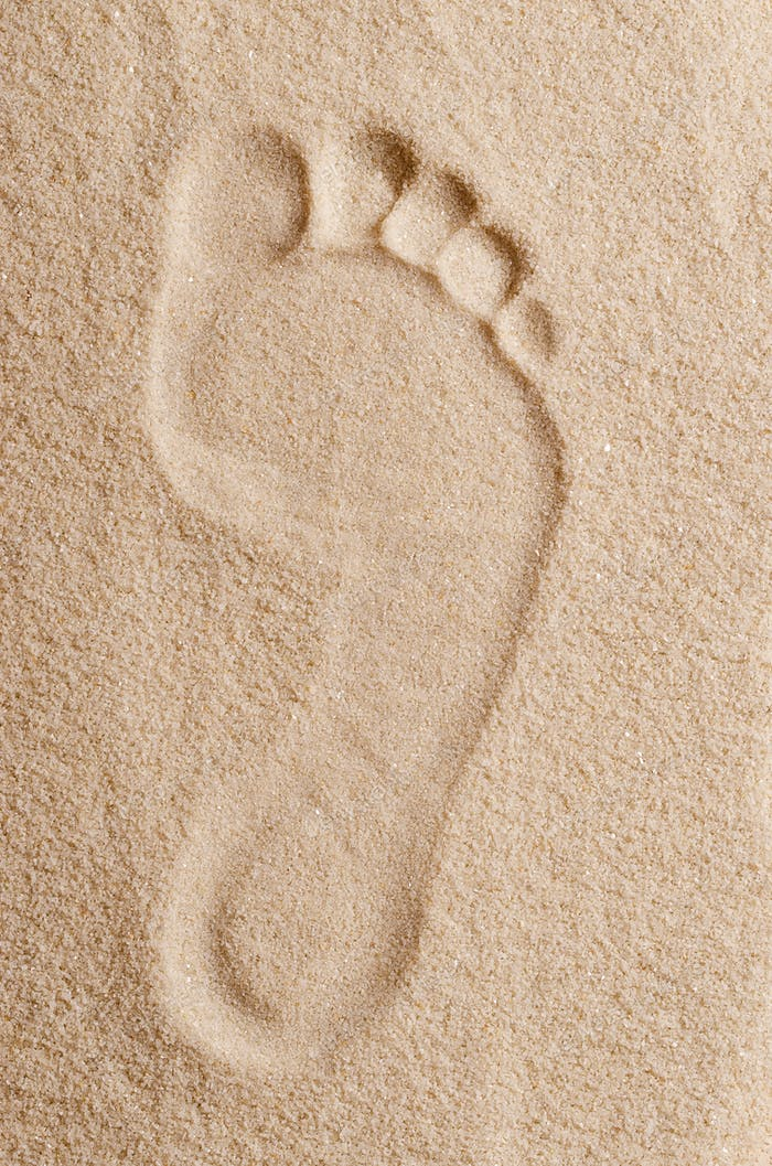 Footprint in the sand macro photo