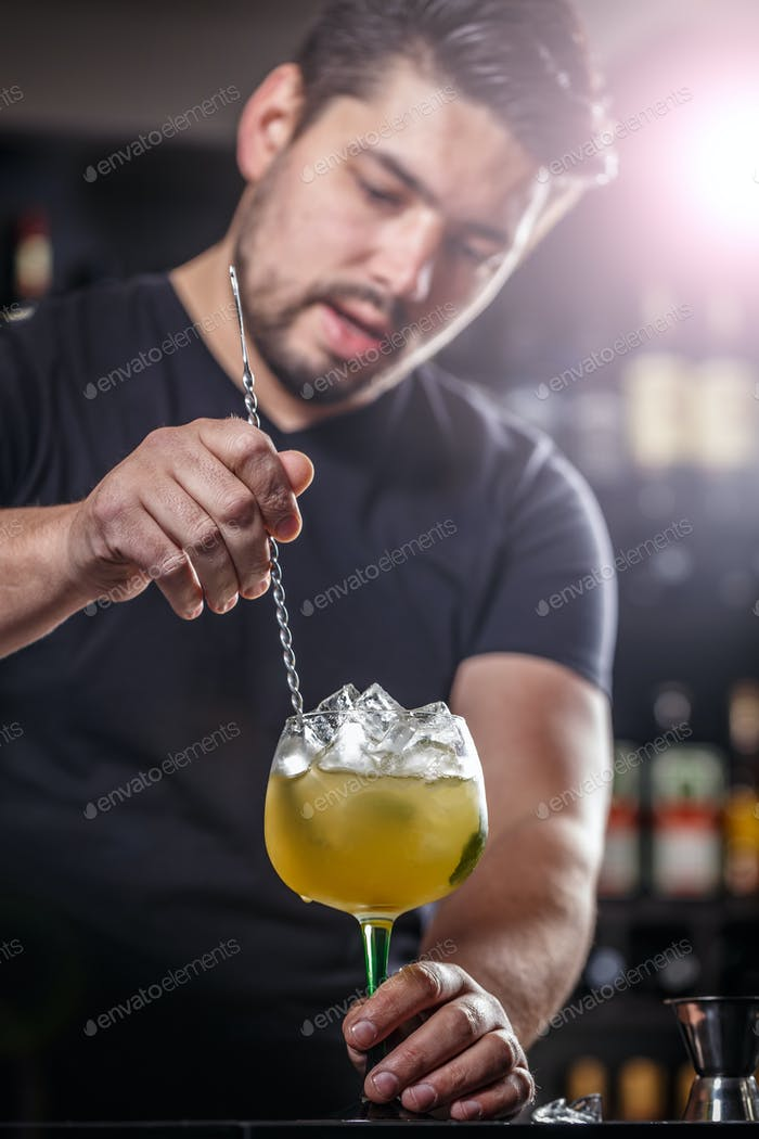 Bartender is stirring cocktail