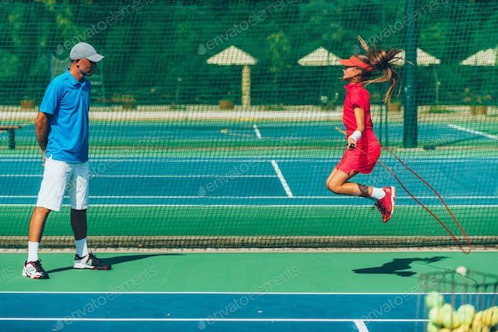 Tennis girl jumping rope