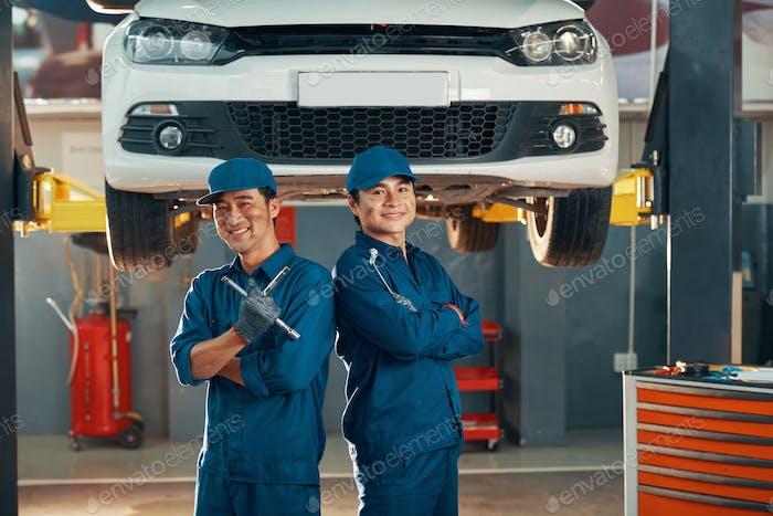 Mechanics working in auto service