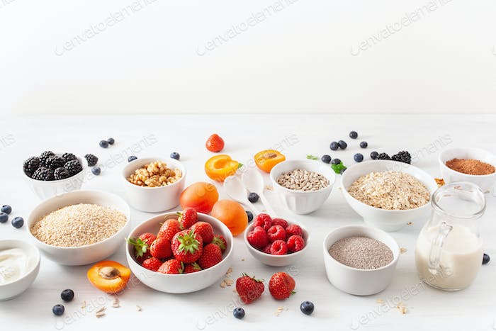 variaty of raw cereals, fruits and nuts for breakfast. Oatmeal f