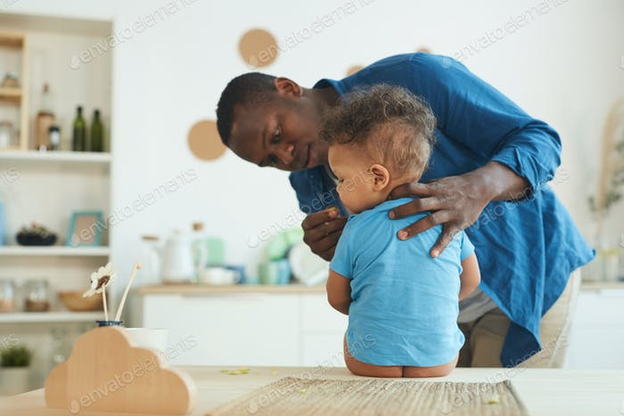 African-American Father Caring for Baby Boy