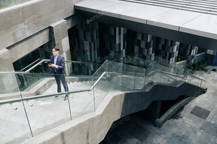 Lost man standing on stairs