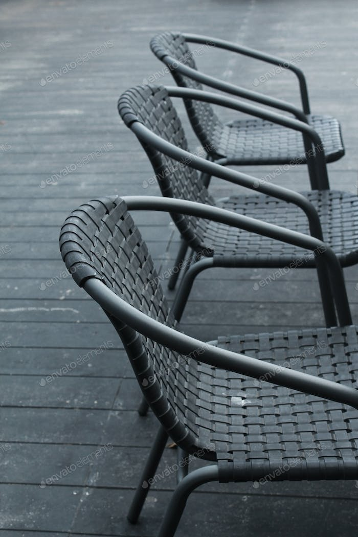 Black chairs in a outdoor cafe