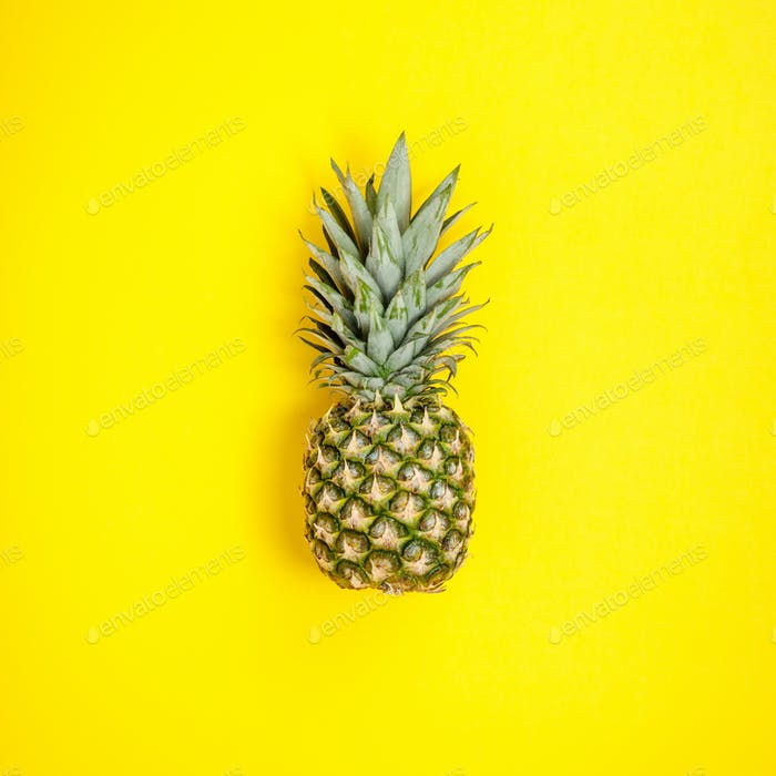 Pineapple on yellow background. Summer concept. Flat lay