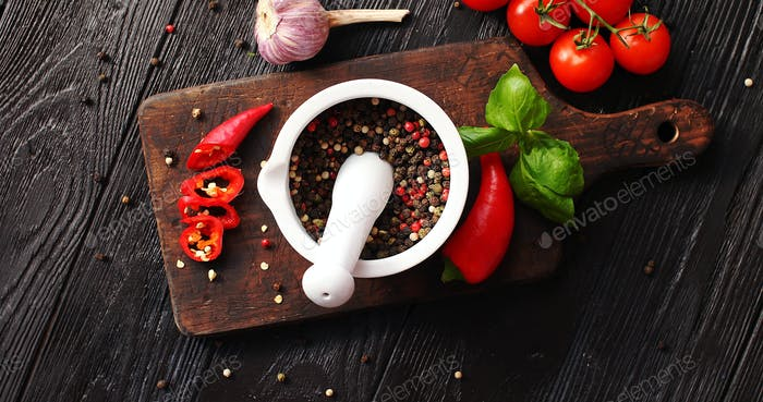 Bowl with spices on chopping board