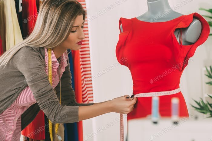 Fashion Designer Takes Measure