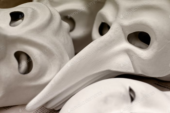Big group of unfinished traditional Venice masks, plain white paper