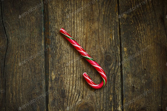 Christmas candy cane on a wooden background