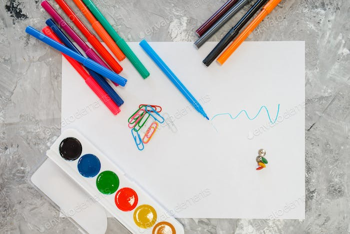 Paints and pencils on the table, stationery store