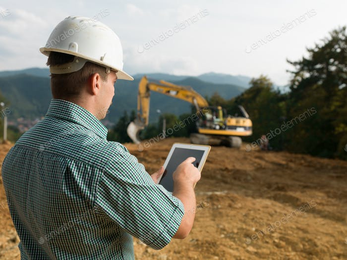 architect checking plan on tablet