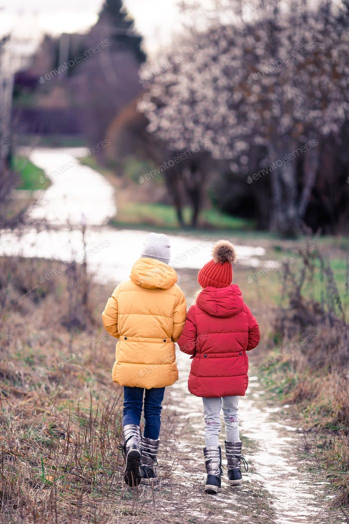 Adorable little girls outdoors in the forest