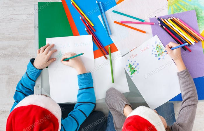 Children writing letter to santa, wait for christmas, top view