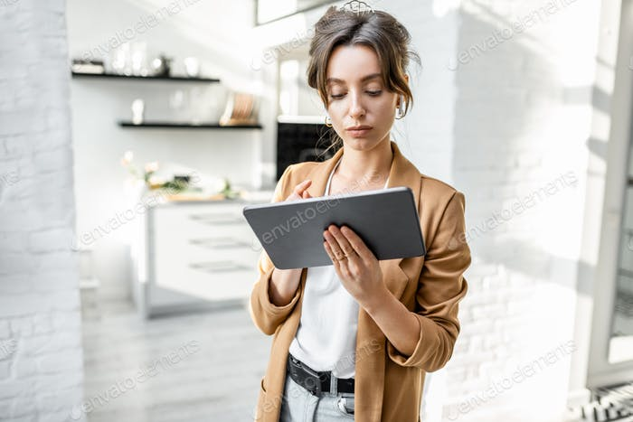 Business woman with digital tablet at home